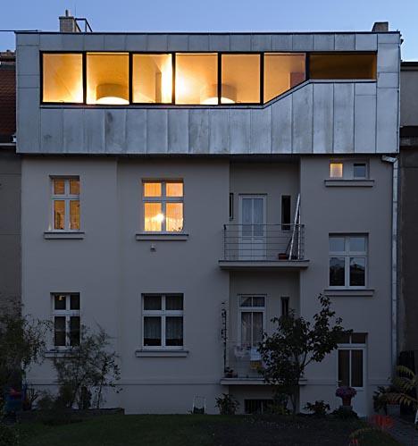 modern metal mansard roof addition