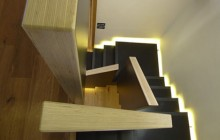 Ethereal Staircase Floats Between Apartment S Dual Levels