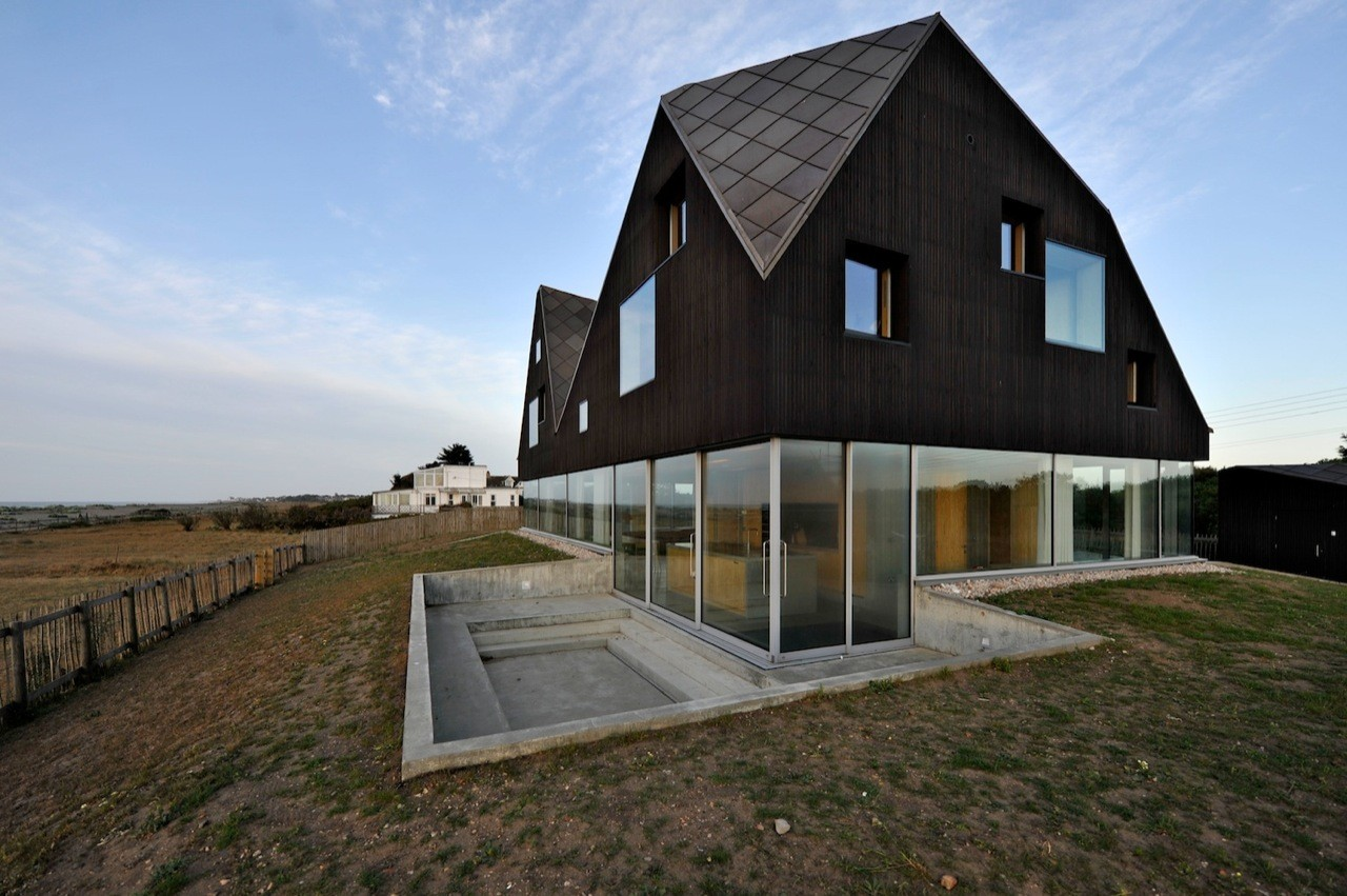 Floating on Air: Home's Transparent First Floor Creates a Cool Illusion