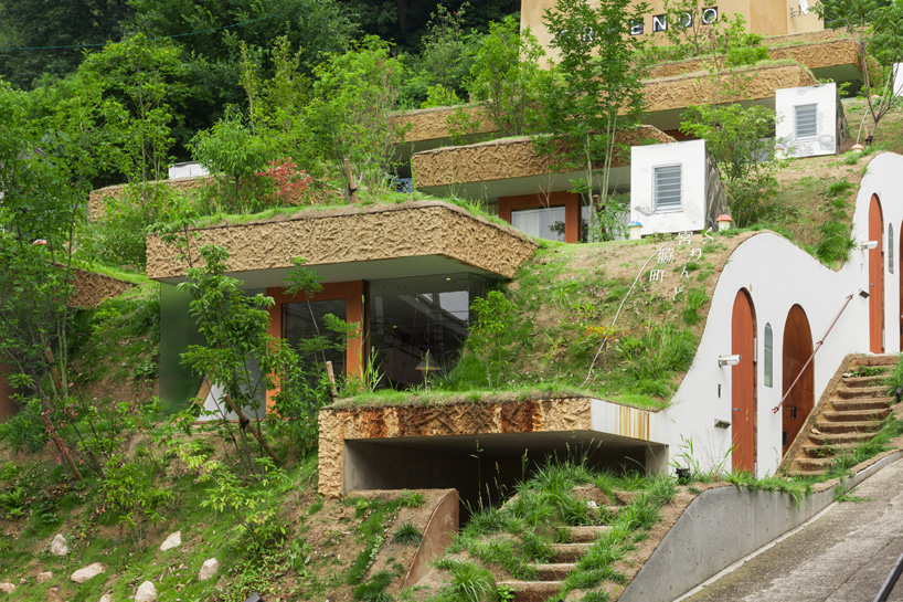 Green Hills in the City: Undulating Apartment Building Built Into the Mountainside